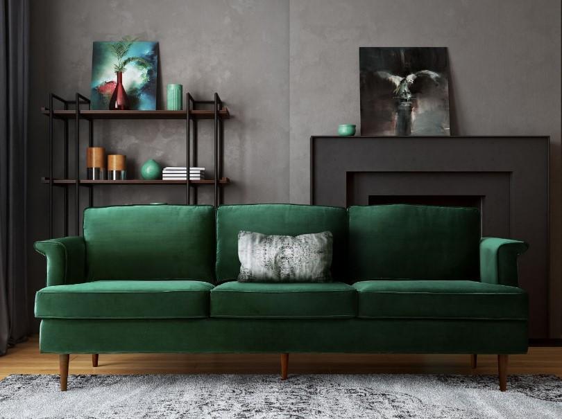 Зеленый диван в темном интерьере