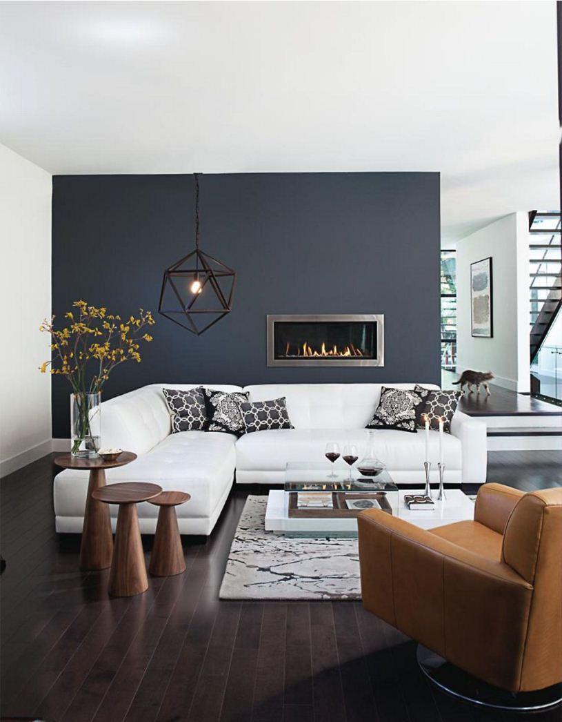Серая стена и белый диван